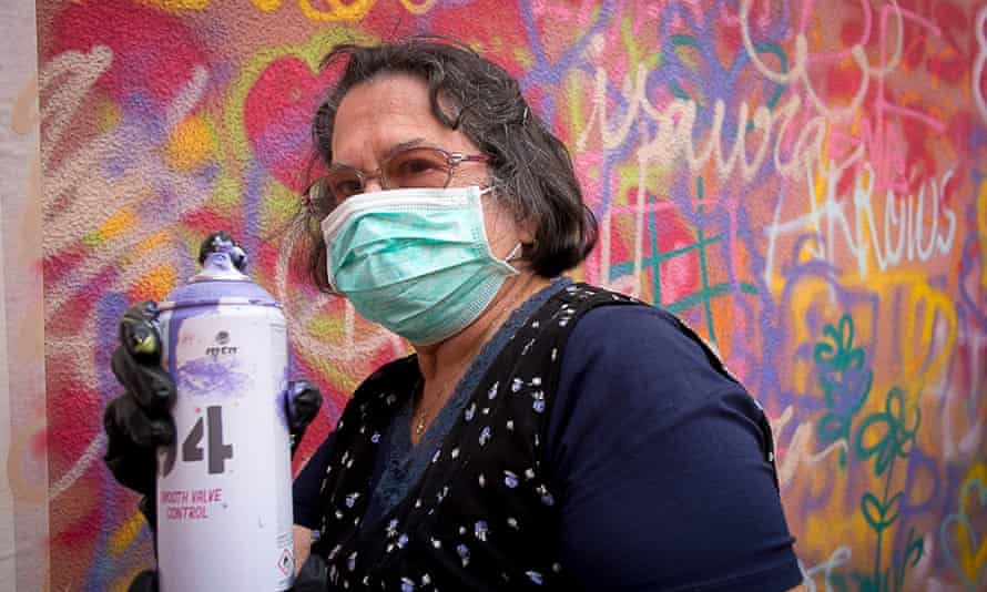 Aida Alves, 76, masked and ready to paint.