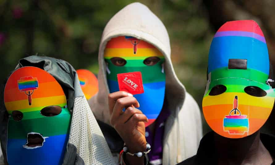 Masked Kenyan supporters of the LGBT community protest against Uganda's anti-gay bill in Nairobi, Kenya.