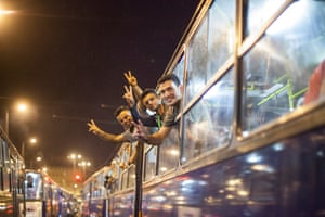 Refugees board buses that will finally take them to Austria after days of being stranded at Keleti Railway Terminus.