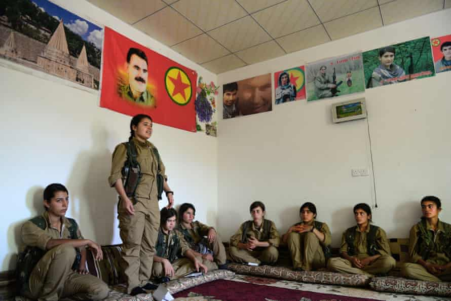 Yazidi girls take part in an education session by the YPJ in Sinjar.
