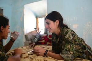 Rosa, 21, and Rajbin, 19, take a break. One of the fighters' most cherished freedoms is to smoke.
