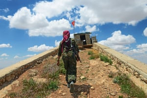 Dijla, 30, heads to guard a lookout over the town of Sinjar.