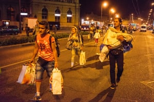 Refugees board buses that will finally take them to Austria after days of being stranded. The Hungarian government chartered dozens of buses to take the refugees away in the middle of the night. It took under 3 hours to empty the station of almost all its refugees.