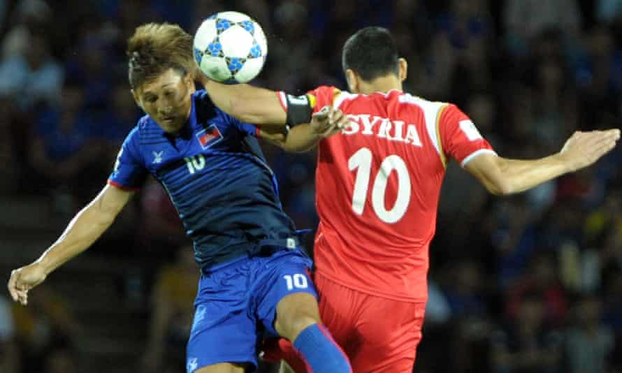Kouch Sokumpheak of Cambodia (L) fights for the ball with Abdulrazak Al Husein of Syria (R) during the 2018 World Cup qualifying football match between Cambodia and Syria in Phnom Penh on September 8, 2015.