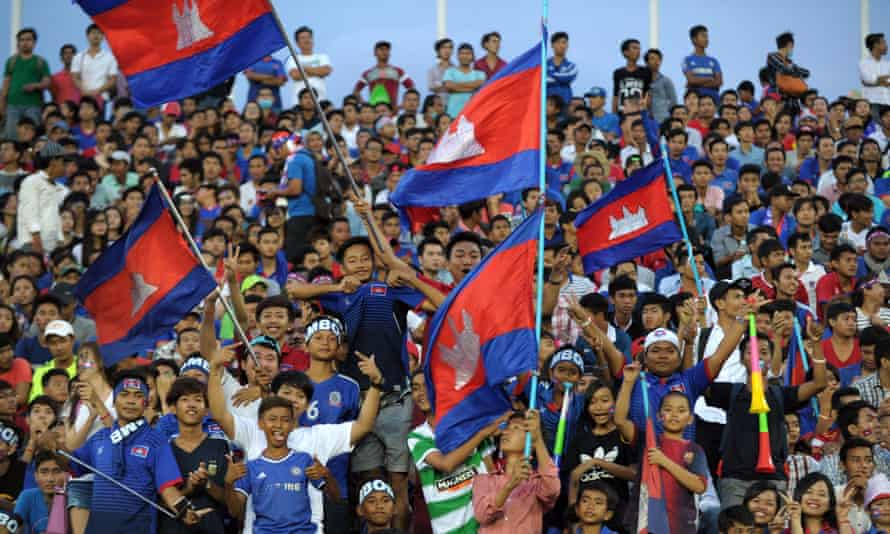 Cambodian fans wave the national flag during the  match between Cambodia and Syria.