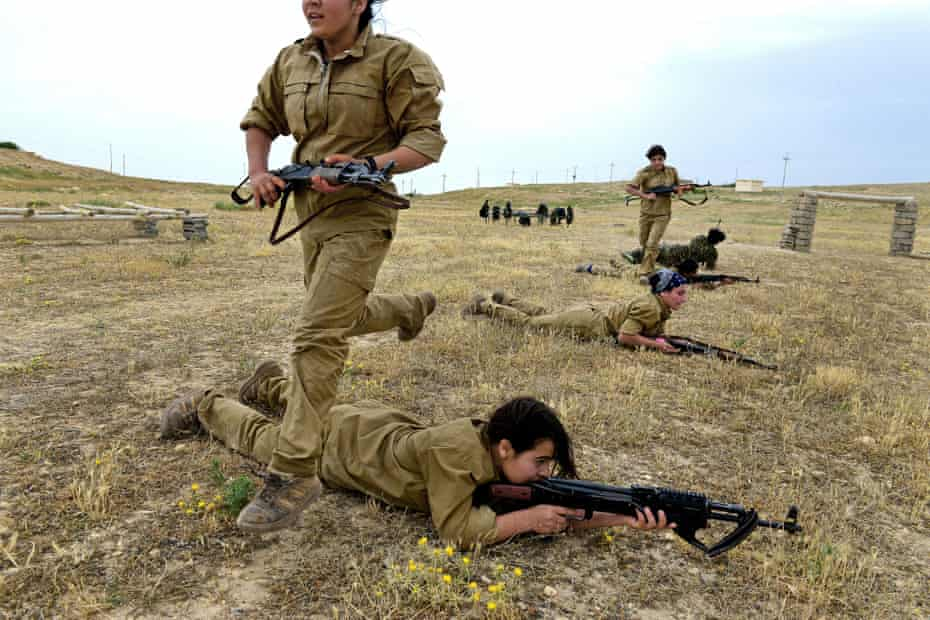 Yazidi girls take part in a military training session organised by the Kurdish Women's Protection Unit (YPJ) in the Sinjar region of Iraq. All photographs by Alfred Yaghobzadeh.
