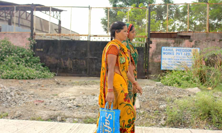 Women head to work in the assembly unit of a factory in  Pithampur.