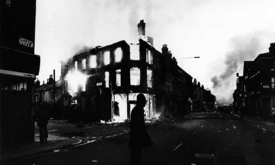 A policeman stands guard after another night of rioting in Toxteth.