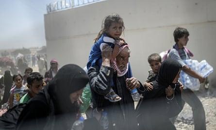 TOPSHOTS Syrians fleeing the war walk to