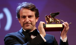 VENICE, ITALY - SEPTEMBER 12:  Director Lorenzo Vigas on stage with the Golden Lion Award for Best Film for 'From Afar' at the closing ceremony during the 72nd Venice Film Festival on September 12, 2015 in Venice, Italy.