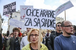 Banners at a rally in Krakow declare that refugees are welcome in Poland
