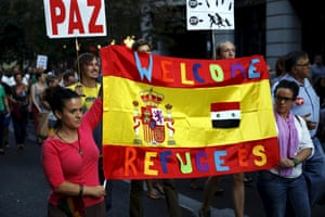 People carry a Spanish flag during the Madrid demonstration