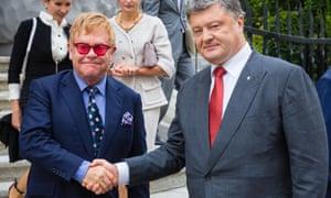 Elton John and Petro Poroshenko shake hands after their meeting in Kiev, Ukraine.