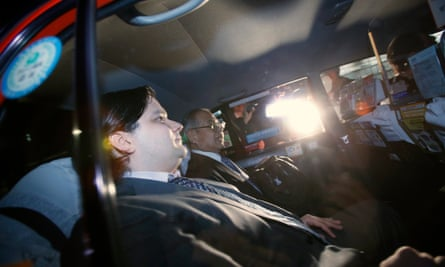 Mark Karpeles (L), chief executive of Mt. Gox, leaves in a taxi after a news conference at the Tokyo District Court in Tokyo February 28, 2014.