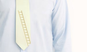 A businessman's shirt and tie which has a ladder on it