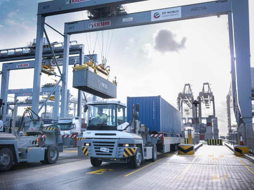 An automated stacking crane and terminal tractor at London Gateway.