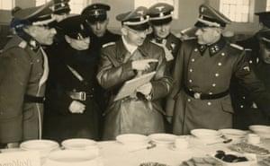 Himmler inspecting Allach porcelain at Dachau on 20 January 1941.