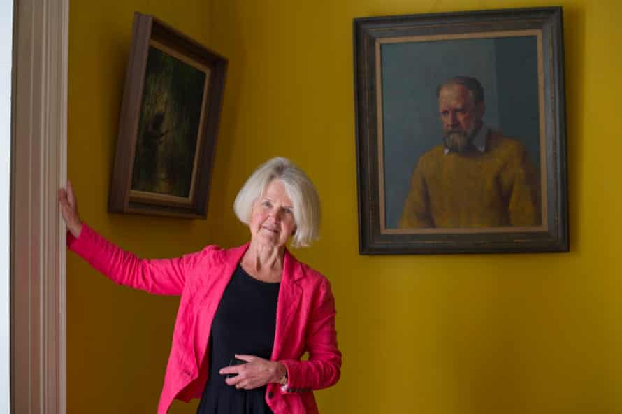 Judy Golding stands before a portrait of her Nobel prize-winning father at his former home in Cornwall.
