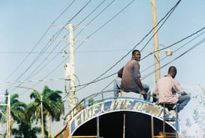 Two men on a tap tap, Port au Prince, Haiti