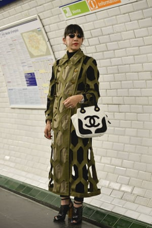 A fashion student wearing a Comme coat on the Paris Metro.