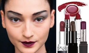 model's face wearing dark red lipstick, and a group of lipsticks next to her