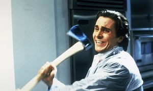 A smiling Christian Bale with an axe in his hand in American Psycho