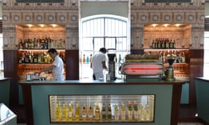 Waiters work in a bar designed by US film director Wes Anderson in Milan.