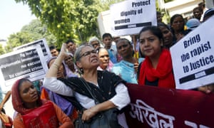 Indian women's rights demonstrators hold a protest outside Saudi Arabia's embassy in New Delhi over the alleged rape of two Nepali maids by a diplomat.
