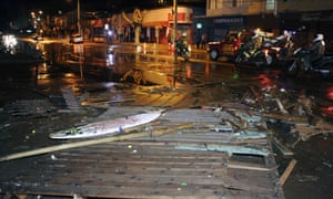 Police patrol a debris strewn street in Valparaiso, Chile, after a tsunami, caused by an earthquake hit the area, Wednesday, Sept. 16, 2015.