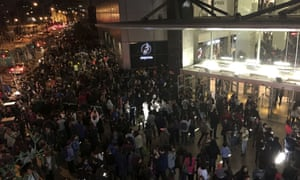 People evacuate a mall in Santiago after a powerful earthquake, in Santiago, Chile, Wednesday, Sept. 16, 2015.