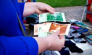 Local currency in use at the launch of the Exeter pound