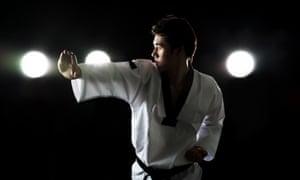young man doing taekwondo