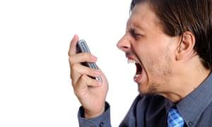 angry man shouting at mobile phone