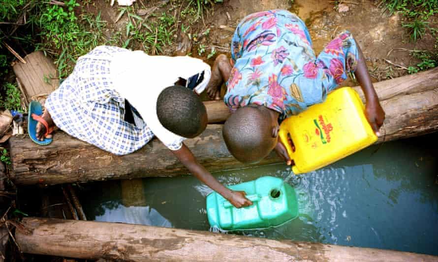Children collect drinking water in Uganda.