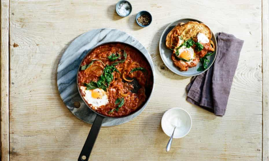 Stovetop baked eggs with rocket and sage
