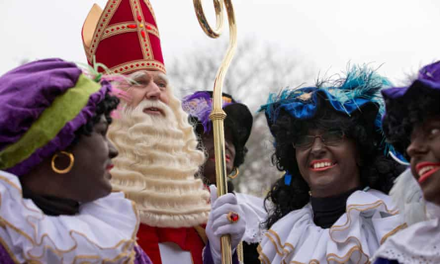 The Dutch version of Santa Claus and his sidekicks known as  Black Pete in Hoorn, north-western Netherlands in 2013.