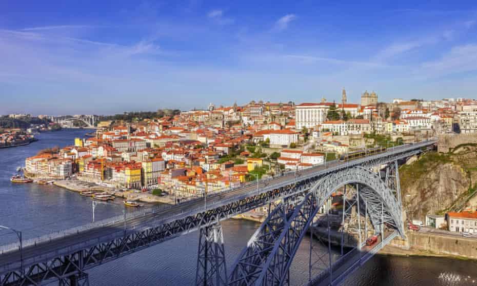  T he iconic Dom Luis I bridge crossing the Douro River.