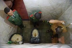 Ai's work S.A.C.R.E.D., in which six dioramas contain half-lifesize effigies of himself and his guards