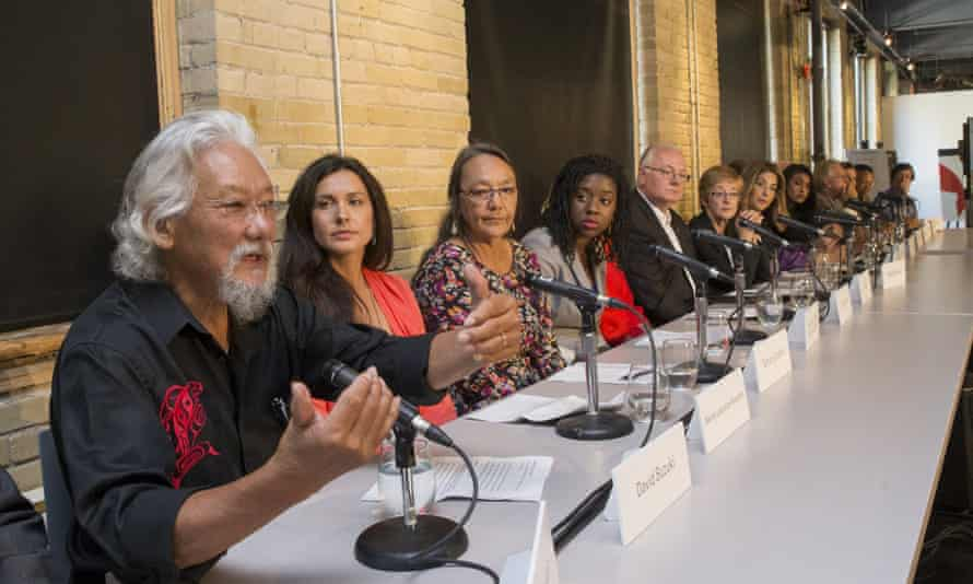 """Environmental activist David Suzuki, Naomi Klein and several others speak during a news conference to launching """"Leap Manifesto: A Call for a Canada Based on Caring for the Earth and One Another"""" in Toronto on September 15, 2015."""