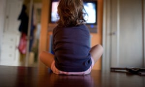A young girl watches television.