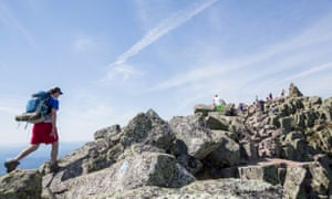 Hikers on the Knife Edge Trail to Baxter Peak of Mount Katahdin, the northern terminus of the Appalachian Trail.