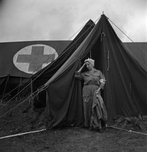 An exhausted  nurse at the 44th evacuation hospital, Normandy, France, 1944