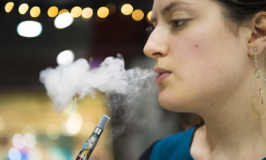 Vaper at an electronic cigarette shop, Covent Garden, London - 12 Nov 2014
