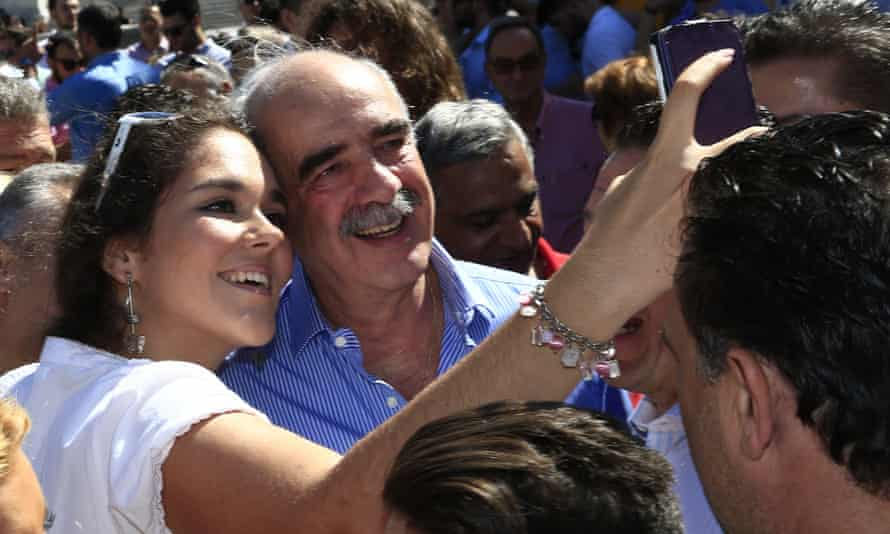 New Democracy leader Vangelis Meimarakis poses for a photograph with a supporter