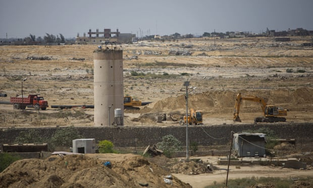 Bulldozers and diggers work on the Egyptian side of the Gaza border.