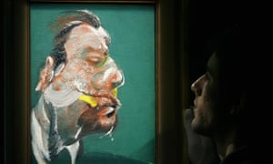 A member of Sotheby's auction house adjusts a painting entitled 'Study for Head of George Dyer' (1967). The painting is valued in excess of £8m.