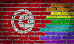 A rainbow flag is seen on a wall alongside the Tunisian flag. Article 226 of the country's constitution rules against outrages to public decency.