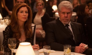 Dana Delaney and Ron Perlman in Hand of God.