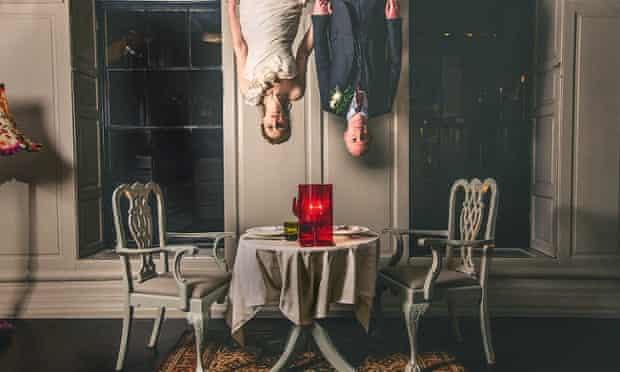 bride and groom upside down