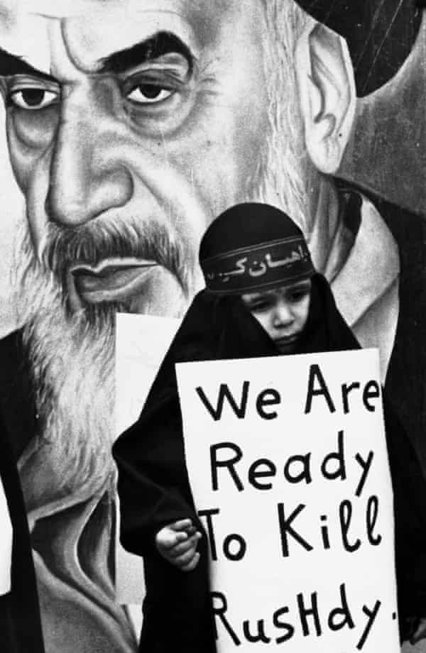 A girl in Beirut carries a sign vowing to kill author Salman Rushdie in February 1989.
